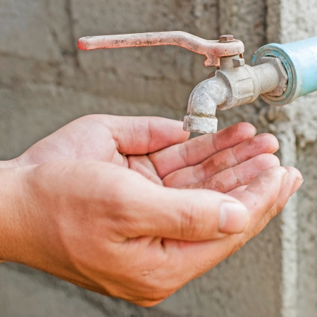 Hand wait for water from old faucet