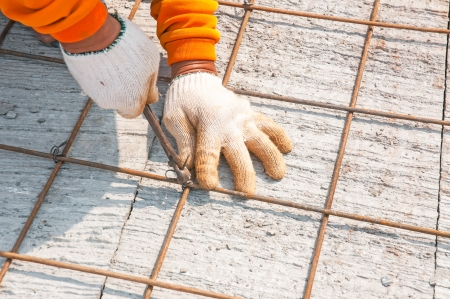 gridwork: Worker, rebar gridwork across a floor for strength
