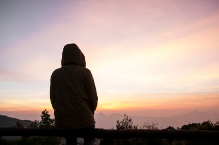 Sitting alone at sunset