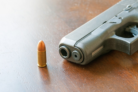 9mm bullets and gun on table
