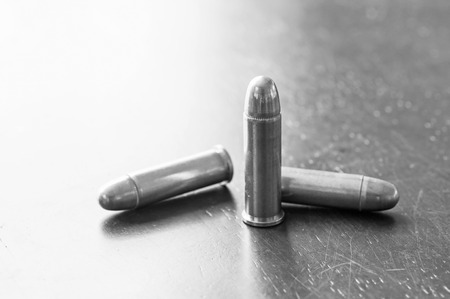 Black and white, 9mm bullets on table