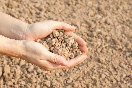humus: soil- handful,female hands, humus soil
