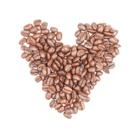 Coffee beans in shape of heart photo