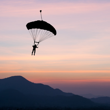 parachute: parachute at sunset silhouetted
