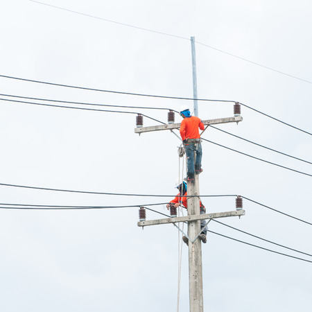 journeyman: Electrician lineman repairman worker at climbing work on electric post power pole