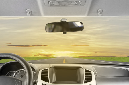 rear view mirror: Drive to sunset. Stock Photo