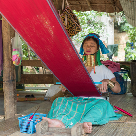BAN NAI SOI, MAE HONG SON PROVINCE, THAILAND - OCTOBER 21: Karen tribe woman with rings on neck in Ban Nai Soi, Thailand, October 21, 2014. Famous tourist destination