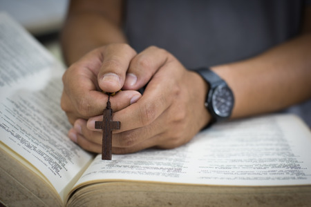 roman catholic: prayer over a Bible Stock Photo