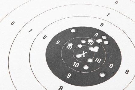 Close up of a shooting target and bullseye with bullet holes Reklamní fotografie
