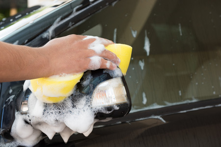 Hand hold sponge for washing the car. photo