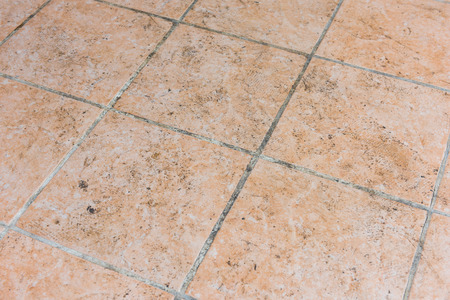 Mildewed tiled floor Stock Photo