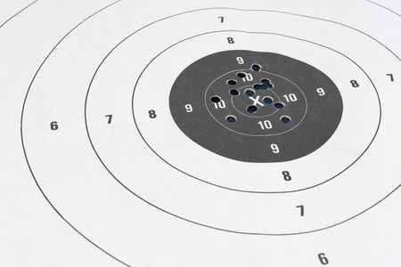 Close up of a shooting target and bullseye with bullet holes Stock Photo