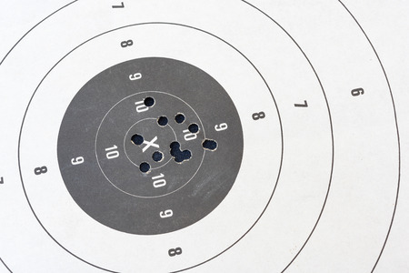 Close up of a shooting target and bullseye with bullet holes Stockfoto