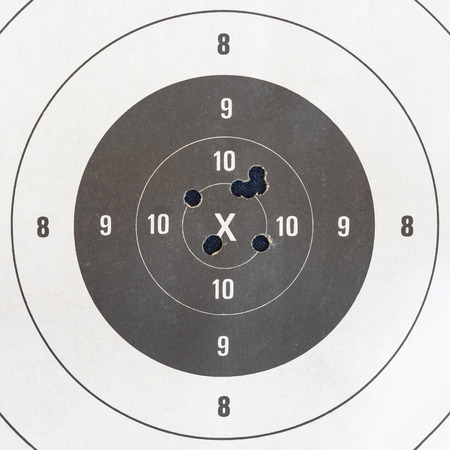 sniper training: Close up of a shooting target and bullseye with bullet holes Stock Photo