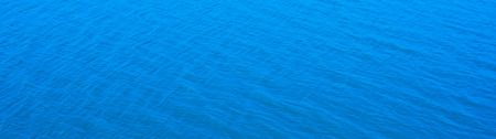 vast: Abstract  panorama blue water sea for background Stock Photo