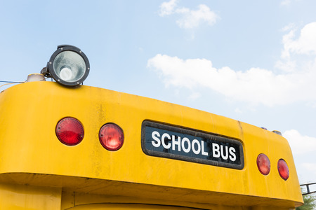 schoolbus: A top front of a schoolbus over a blue sky