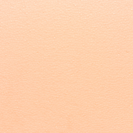 styrene: light orange for the background. Stock Photo