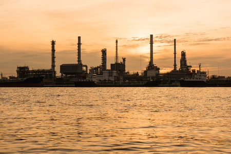 indutry: Oil indutry refinery - factory with dramatic sunrise