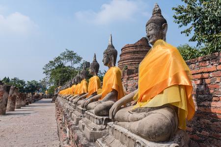 chaimongkol: Aligned buddha statues at Wat Yai Chaimongkol, Ayutthaya, Thailand. Stock Photo