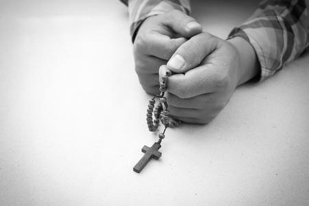 jesus hands: Black and white, prayer man hand with rosary Stock Photo