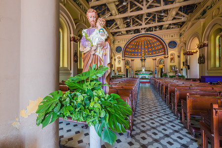 st  joseph: AYUTTHAYA, THAILAND - SEPTEMBER 25: The statue of St. Joseph with interior of church of St Joseph with altar, on September 25, 2015 in Ayutthaya, Thailand Editorial