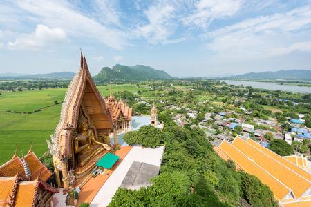 sua: Big Buddha statue at Kanchanaburi Province in Thailand, Tiger Cave Temple Wat Tham Sua Stock Photo