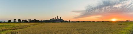 sua: Panorama landscape of Thai temple  Wat Tham Sua  and rice field in sunrise at Kanchanaburi, Thailand