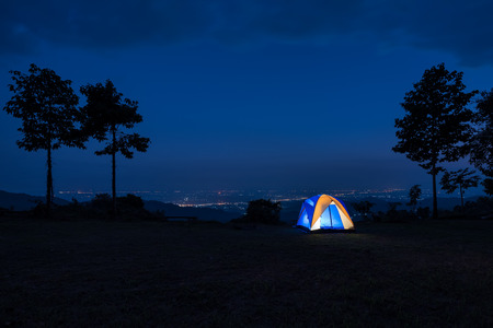 tent city: Illuminated Blue Camping tent at Night