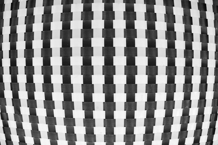 chequer: black and white squares plastic in a checkerboard background Stock Photo
