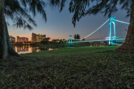 thani: Beautiful suspension bridge in a park city at sunset. Udon thani, Thailand.