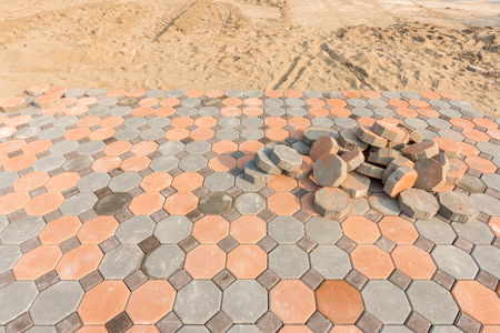 Installing paver bricks on patio Stock Photo