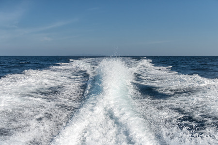 Background water surface behind of fast moving motor boat Stock Photo