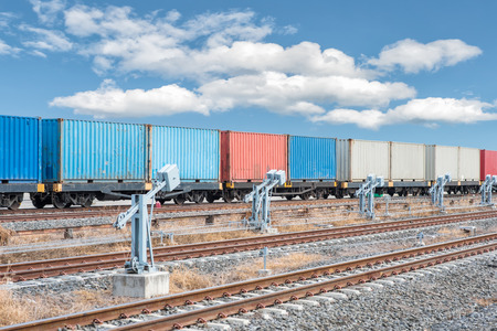 flatcar: container trains with blue sky
