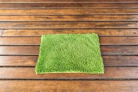 floor mat: Green rug on wood floor