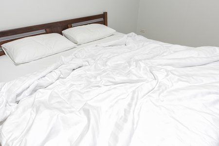 messed: Bed sheets and pillows messed up after nights sleep.