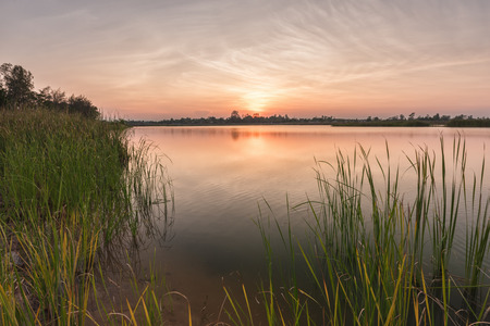 eventide: Landscape of calm lake at sunset Stock Photo