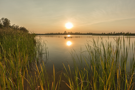 eventide: Landscape of calm lake at sunset� Stock Photo