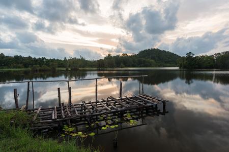 Landscape of calm lake at sunset Stock Photo