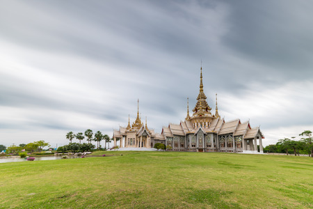 the emerald city: Landmark wat thai, Long shutter speed exposure of sky in temple at Wat None Kum in Nakhon Ratchasima province Thailand Stock Photo