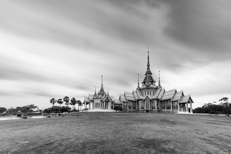 Black and white, Landmark wat thai, Long shutter speed exposure of sky in temple at Wat None Kum in Nakhon Ratchasima province Thailand