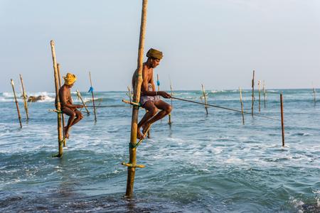 avocation: KOGGALA, SRI LANKA - MARCH 22, 2016: Local men fishing in traditional way. traditional fishermen at the evening near Galle in Sri Lanka.