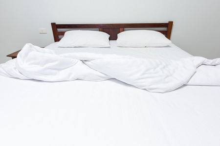 messed up: Bed sheets and pillows messed up after nights sleep.