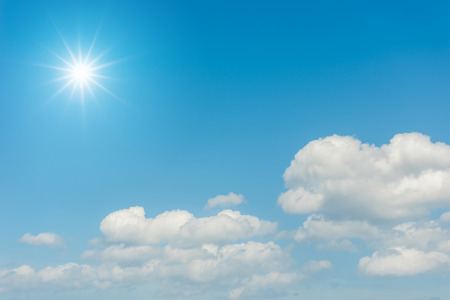 Blue sky with clouds and sun reflection Standard-Bild