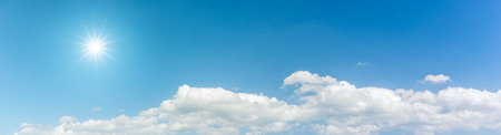 Panorama blue sky with clouds and sun reflection