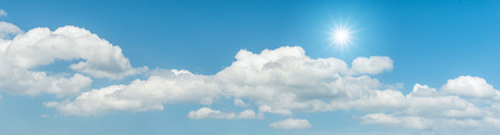 nebulosity: Panorama blue sky with clouds and sun reflection