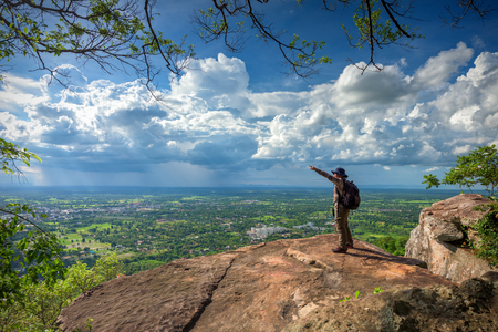 top veiw: Young man traveler on cliff with beautiful landscape
