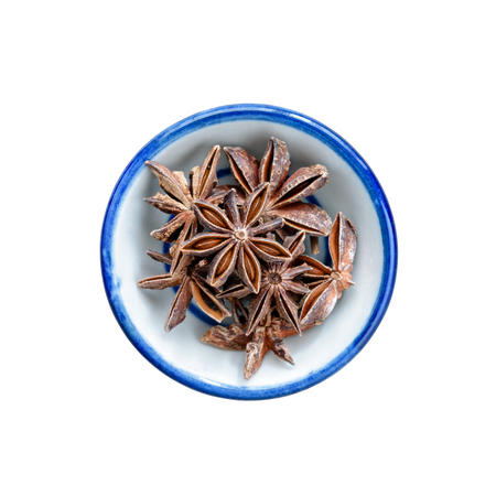 Star anise spice in bowl on white. This has clipping path.