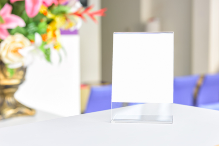 talker: Table tent on wooden table