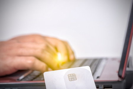 credit card and using laptop computer Stock Photo