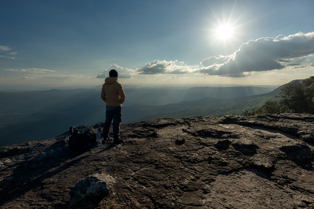 Man hikers tourist standing at the summit climber  Stock Photo